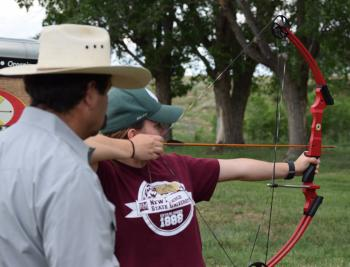 Youth participate in shooting sports activities.